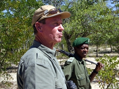 """Norman and a local tracker (a park ranger whose dangerous job involved orders to """"shoot to kill"""" any potential poachers); Matopos National Park"""