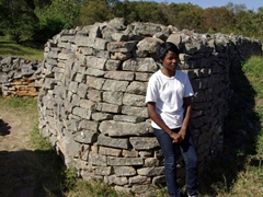 Our Great Zimbabwean Ruins guide patiently explains the history of the ancient complex, which is broken into three sections (the Hill Complex, the Valley Enclosures and the Great Enclosure)