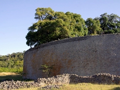 """The massive walls of """"The Great Enclosure"""". At 4 meters thick and 11 meters high, the walls remain in excellent condition; Great Zimbabwean Ruins"""