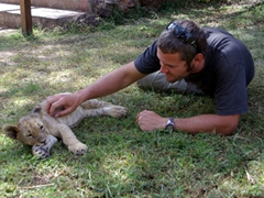 Robby gets up close and personal while playing around with this lion cub