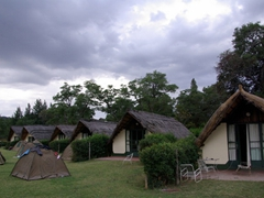 Our tents in front of several rustic cottages; Kuimba Shiri Bird Park in Harare