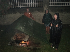 Robby, Nancy and Marie work under arduous conditions to prepare dinner for the group; Little Ritz in Africa Hall in Kabale