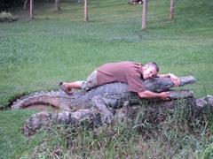 """Robby """"wrestles"""" a crocodile; Bunyonyi Overland Resort"""