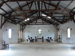 Inside view of a simple brick church; Lake Bunyonyi