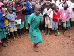 Carolyn is a natural born entertainer, as she leads the way in singing and dancing; Kyabahinga Orphanage