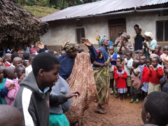 Unable to contain their excitement, the women join in the dancing as they put on a show for us; Kyabahinga Orphanage
