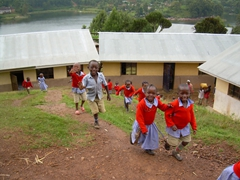 School children swarming around us as they are released for lunch break; Lake Bunyonyi