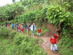 With school children leading the way, we precariously make our way up the slippery mud path to the orphanage; Lake Bunyonyi
