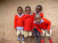 Well behaved boys pose for a photo; Kyabahinga Orphanage at Lake Bunyonyi