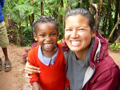 Becky and a sweet schoolgirl pose merrily for the camera; Kyabahinga Orphanage in Lake Bunyonyi
