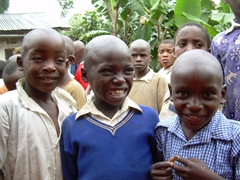 These boys had quite serious faces at first, but we convinced them to break out in their biggest smiles as they posed for the camera; Kyabahinga Orphanage