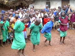And then the girls show us how its done as they sway to the drum beat; Kyabahinga Orphanage