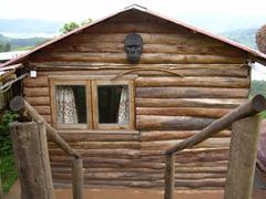 A gorilla mask adorns a wood lodge at Lake Bunyonyi