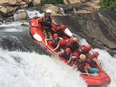 Everyone holds on for dear life as we plunge over the first rapid; Nile River