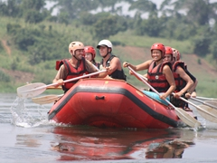We are all smiles on the calm surface of the Nile River (before we reached our first rapid!)