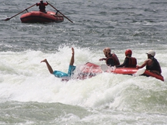 There she goes! Becky does a complete somersault off the raft into the Nile River