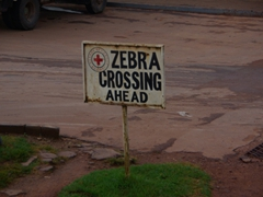 "Signpost for a ""zebra crossing ahead""; Kabale"