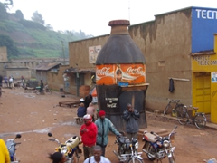 A massive Coca-Cola bottle stands out as effective advertising; Kabale