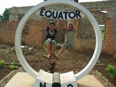 Hanging like monkeys off the Uganda Equator sign