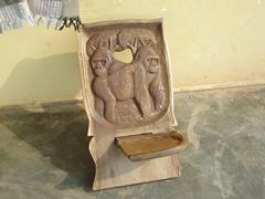 A mountain gorilla wooden chair for sale; souvenir shop on the Equator