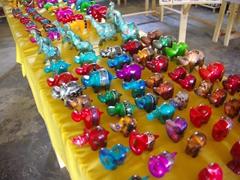 Colorful souvenir hippos for sale; Equator