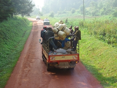 Typical Ugandan public transport (filled to the brim) with passengers hanging off the sides