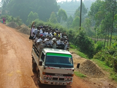 A crowded truck waves a friendly greeting as we pass them enroute to Kabale