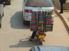 A motorcyclist carries a fragile load of eggs; Kampala