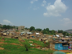 Wooden shacks overtake a suburb of Kampala
