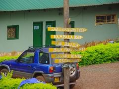 Directional signpost; Jinja's Nile River Explorers campsite