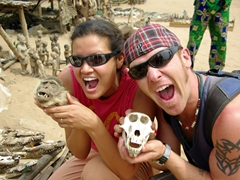 Becky and Lucky pose with monkey skulls; Akodessewa Fetish Market in Lomé