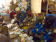 Black market money exchangers conduct brisk business on the streets of Lomé