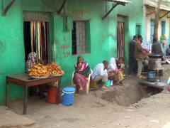 Ladies selling fried doughnuts for breakfast; Harar