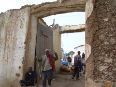 Pedestrians walking through one of Harar's traditional city gates