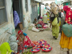 A colorful street scene in Harar captures our attention