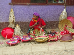 View of a Harar lady selling colorful handwoven baskets