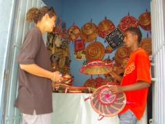Becky bargains hard for a traditional handicraft; Harar