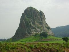 A karst tower dominates the landscape