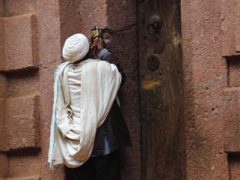 A caretaker unlocks the door of the House of Emmanuel for us to visit; Lalibela