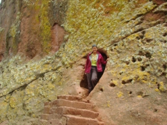 Becky emerges out of a tunnel leading to the House of Emmanuel; Lalibela