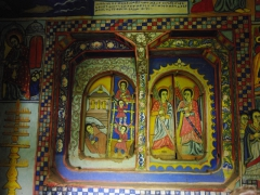 Colorful murals decorate the interior walls of Bete Mariam