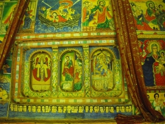 Religious paintings decorate the interior walls of Azwa Mariam Monastery; Lake Tana