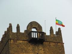 An Ethiopian fag flies proudly over this castle's turret; Gondar
