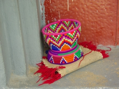 A colorful donation basket sits outside the Church of Jesus Christ; Axum