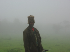 Our Simien Mountain guard models a hand knit cap that the local villagers were trying to sell to us