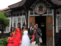 A wedding party on the steps of Addis Ababa Restaurant