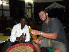 Daniel and Robby prepare for a tej drinking session, a golden sweet honey wine; Addis Ababa Restaurant