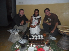 Robby and Dowelly smile next to a lady who performed the Ethiopian Coffee Ceremony at the Seven Olives Hotel in Lalibela