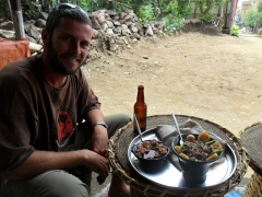 Robby smiles just before devouring his traditional Ethiopian lunch (complete with injera); Lalibela