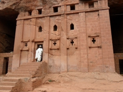 "A priest stands in the doorway of ""Bete Abba Libanos""; Lalibela"